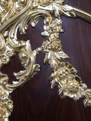 Gilding carvings on a cupboard with 24 carat gold
